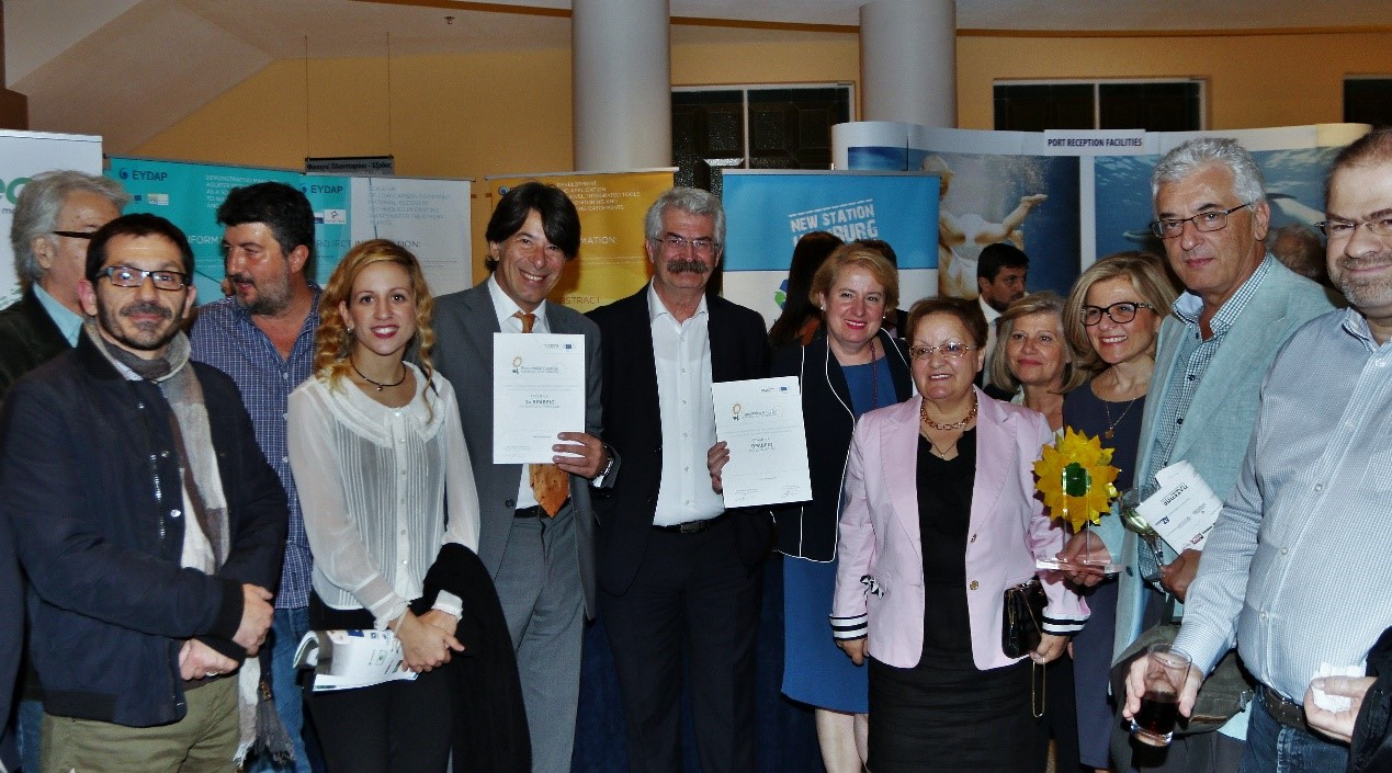 the-eydap-team-together-with-ntua-displaying-the-two-prizes-in-front-of-the-companys-stand-after-the-paseppe-awards